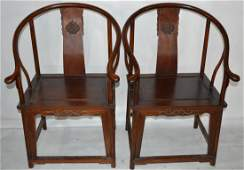 449: Pr. of Chinese Huanghuali wood arm chairs