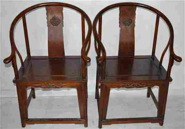 Pr. of Chinese Huanghuali wood arm chairs