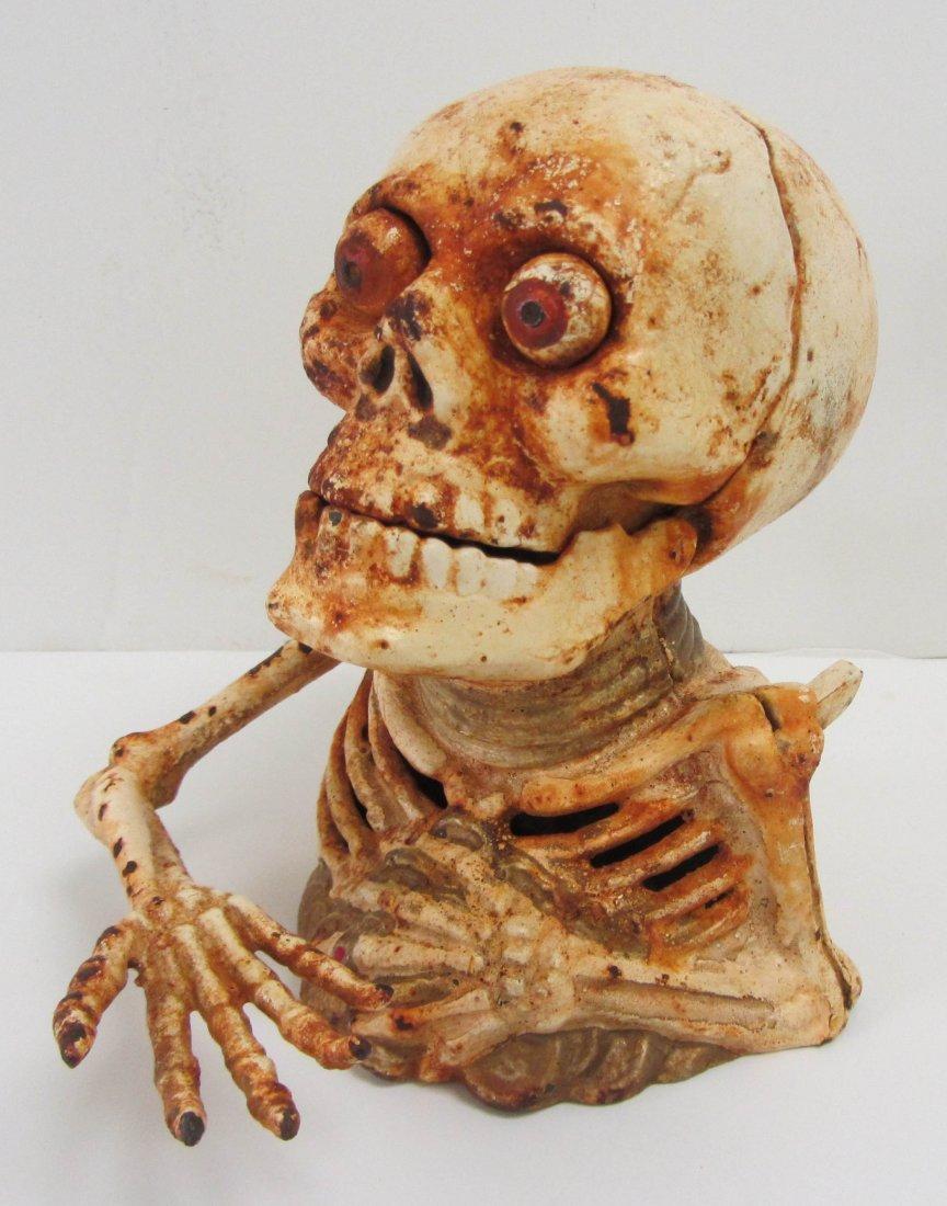 4: Cast iron skeleton bank