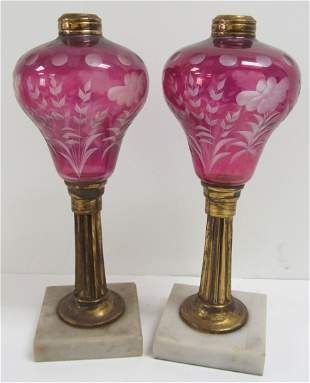 Pr. of etched cranberry glass keroscene lamps