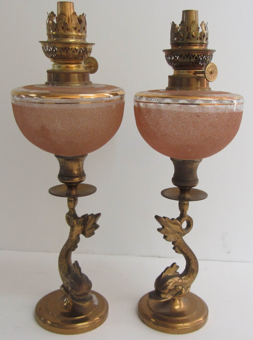 12: Pr. of keroscene lamps with dolphins