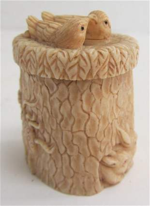 Small carved bone box with birds