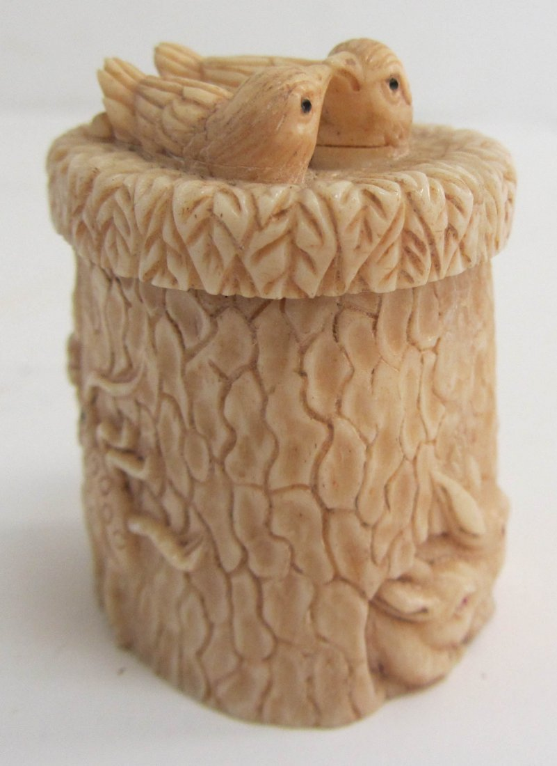 16: Small carved bone box with birds