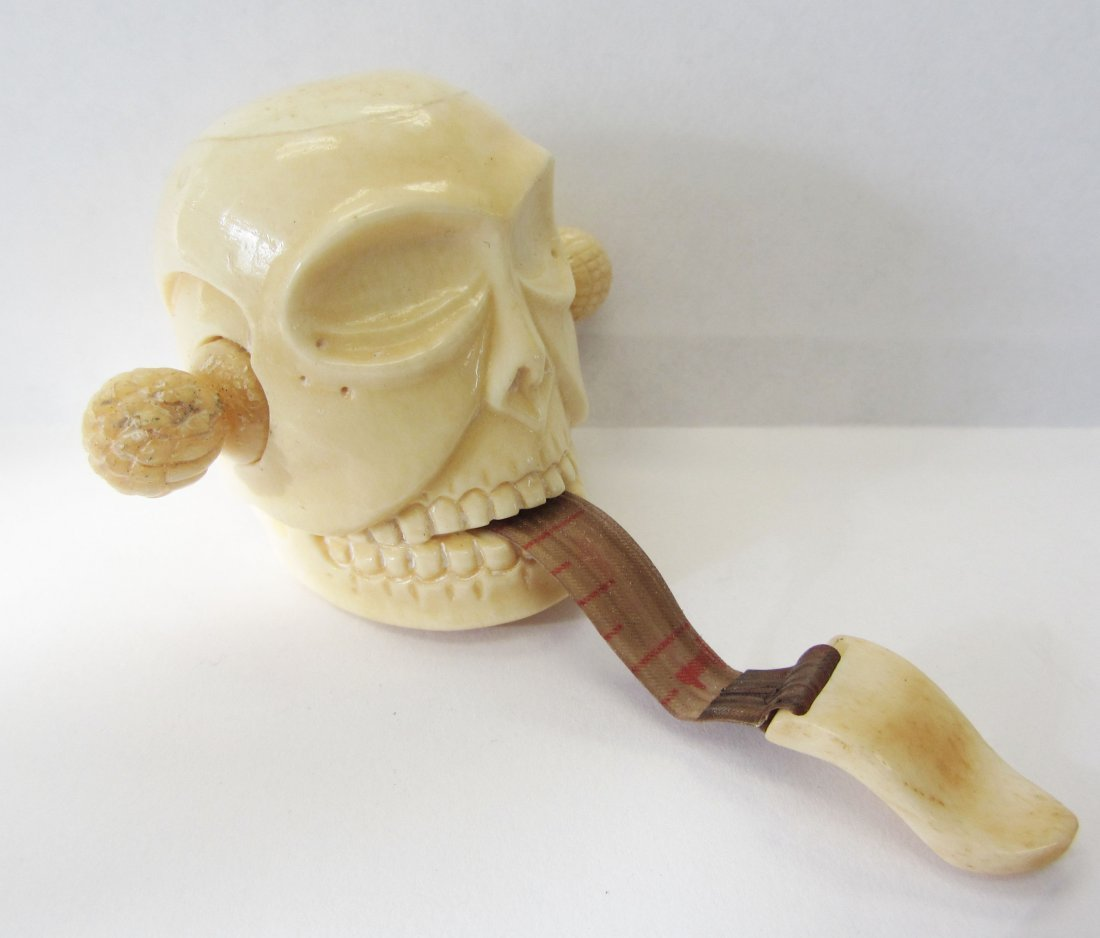 9: Carved bone skull measuring tape