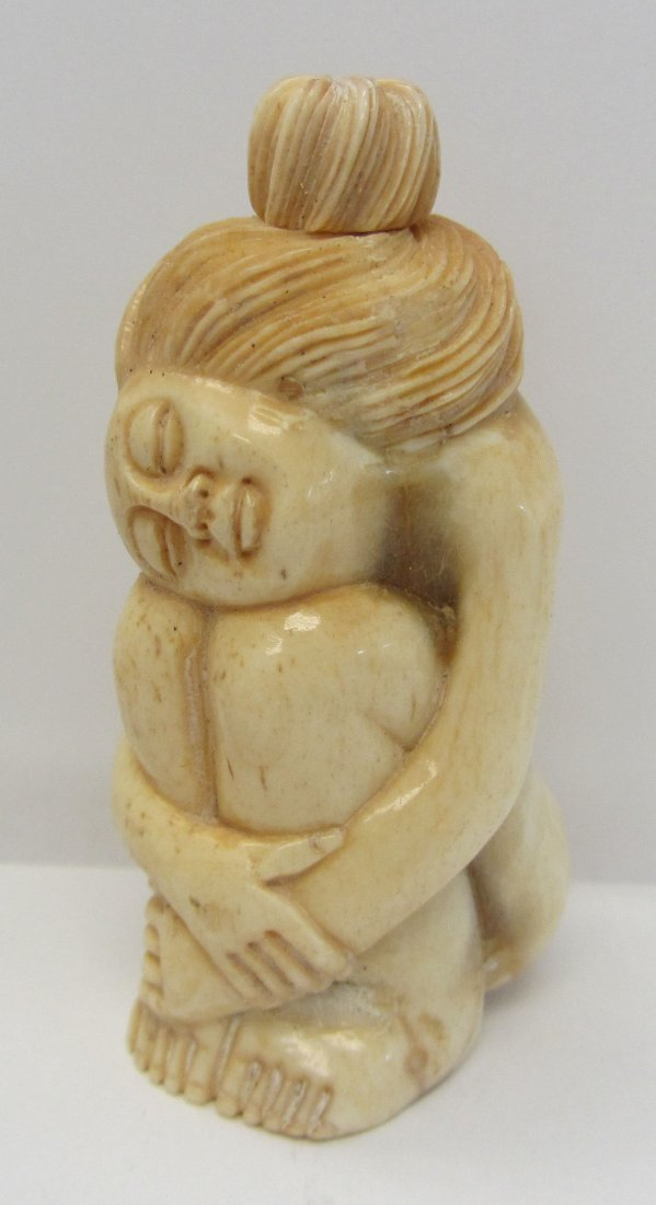 11: Carved bone nude snuff bottle
