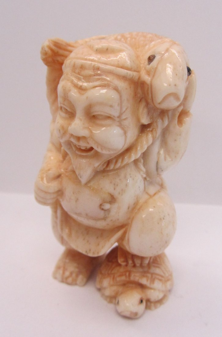14: Carved bone figure of oriental man