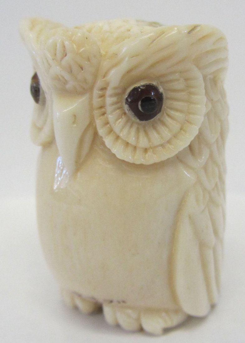 21: Carved bone figure of owl