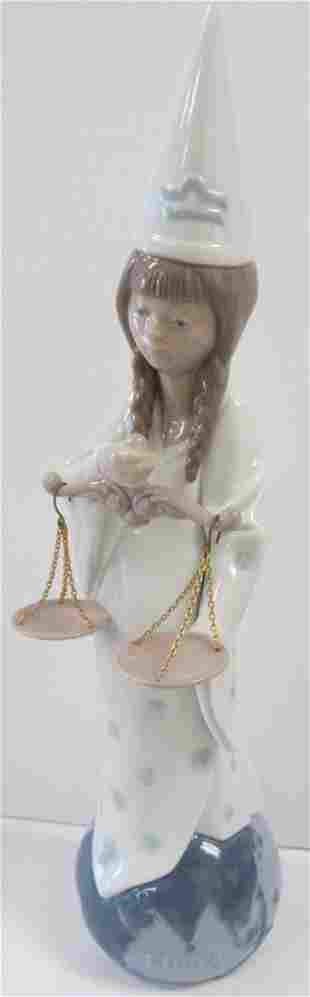 Signed Lladro holding scale
