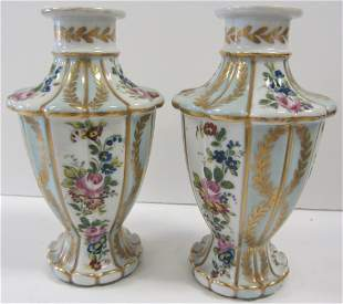 Pr. C1900 porcelain handpainted urns