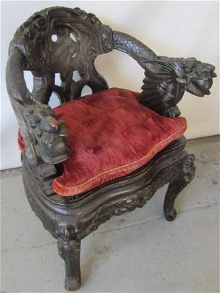 Detail carved Oriental armchair with dragons
