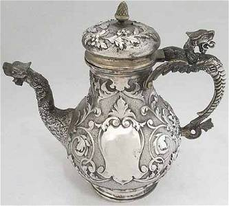 Mid 1800's German repoussee silver tea pot