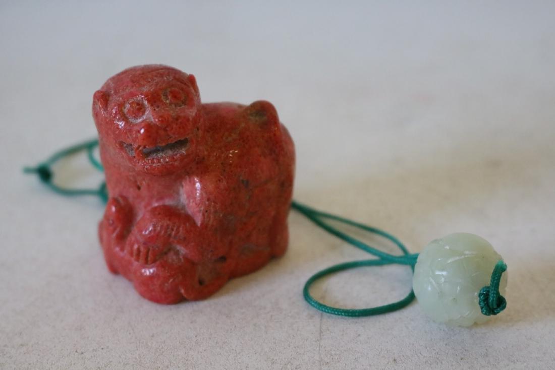 Carved Orange Coral Foo Dog with Jade Bead