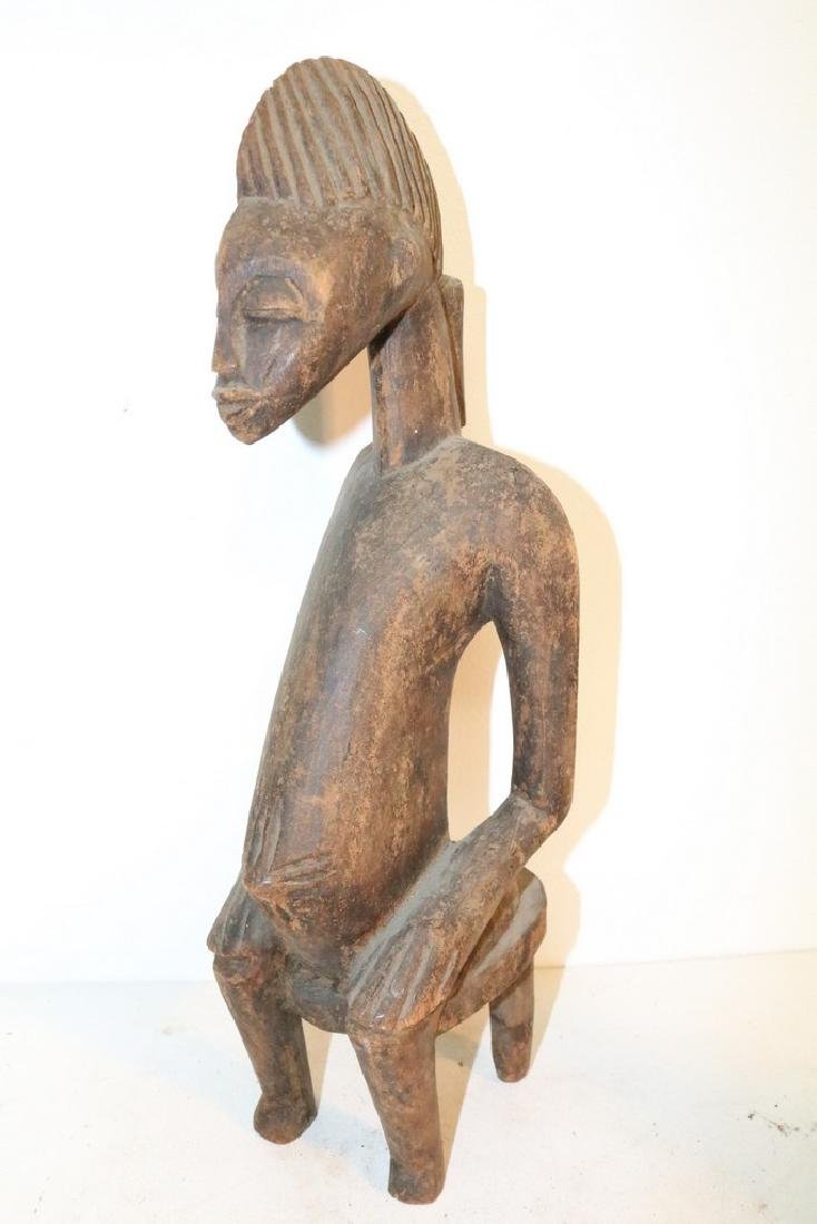 Hand Carved African Statue, seated Man