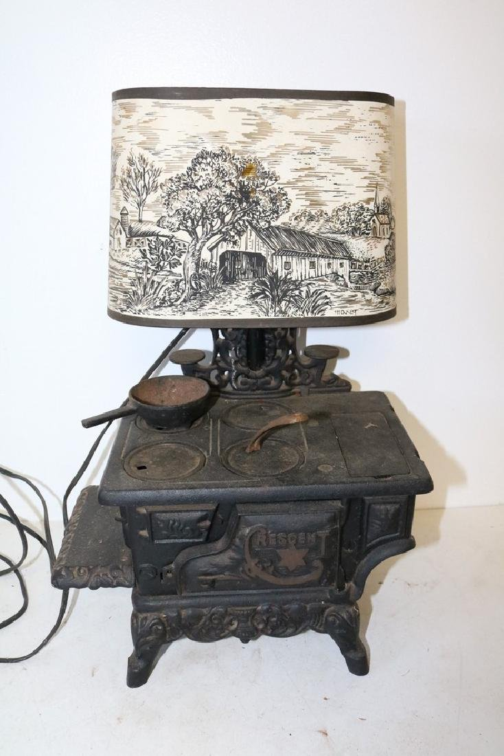 Antique Cast Iron Cresent Stove Lamp with artist signed