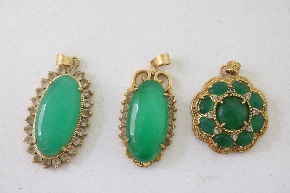 3 Vintage Asian gold and green stone pendants with