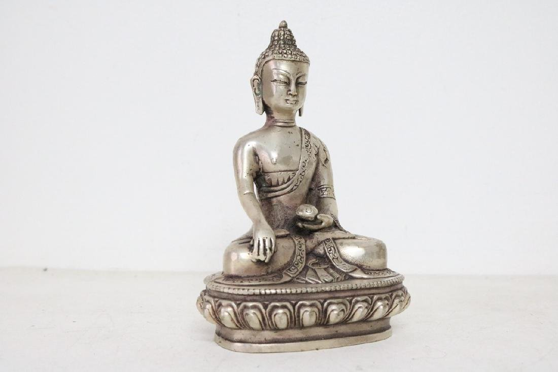 Chinese Silver Buddha w/ floral stamp on bottom