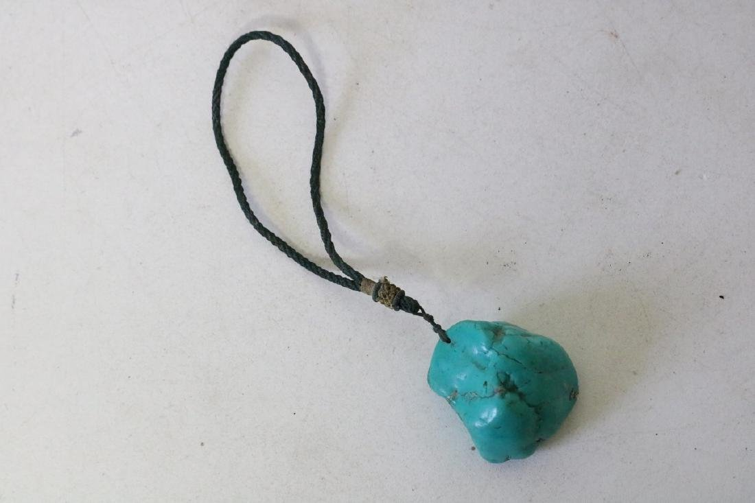 Carved Blue Stone on Rope