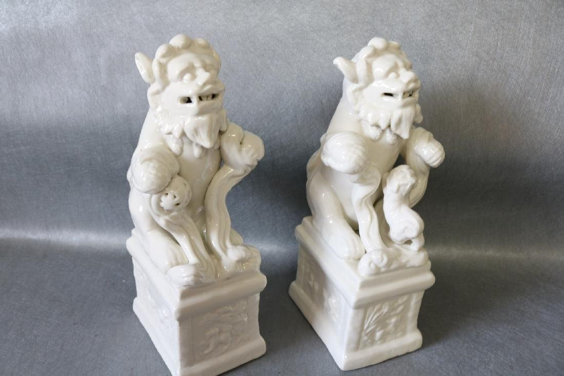 Pair of Vintage White Porcelain Foo Dogs