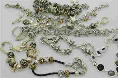 A lot of eight modern silver tone bracelets.