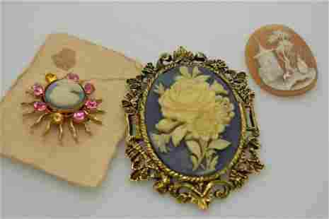 A lot of three vintage, faux & real cameos