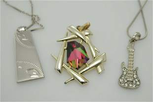 A lot of two necklaces and one pendant with stone. The