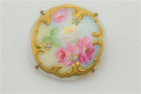 A hand painted porcelain pin/brooch.
