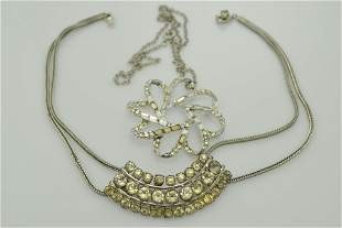 A lot of two silver and rhinestone necklaces. One is