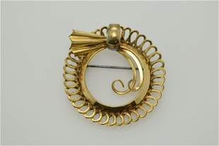 A vintage gold filled pin.