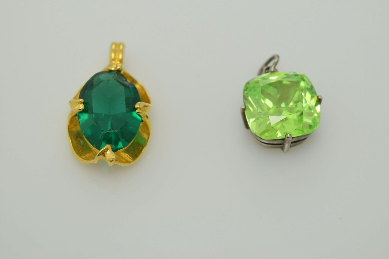 A lot of two single stone pendants.