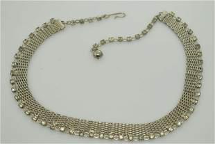 A silver tone & clear rhinestone choker/necklace.