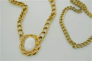 A lot of two vintage necklaces. One is marked Monet.