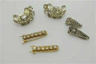 A lot of unmatched rhinestone pieces of jewelry.