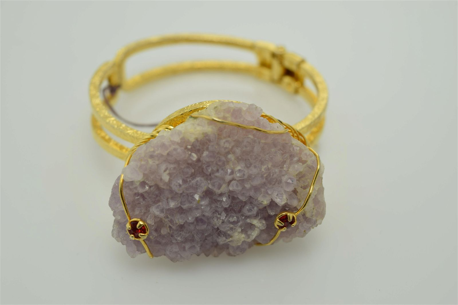 A Hobe signed gold tone clamper bracelet with large