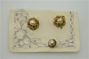 A pair of Haskell clip on earrings and a single pierced