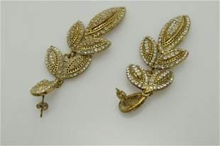 A pair of vintage, gold tone, pierced dangle earrings