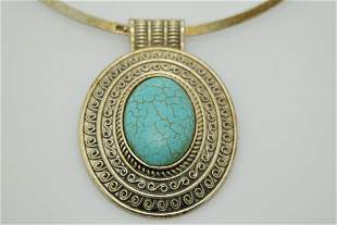 A vintage metal collar choker with faux turquoise