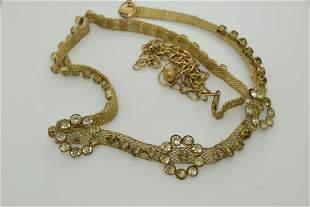 A vintage, gold tone mesh belt with rhinestones.