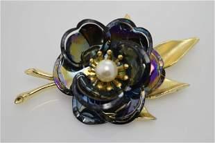 A vintage, black iridescent flower pin/brooch.