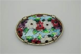 A vintage multi color enamel pin/brooch.