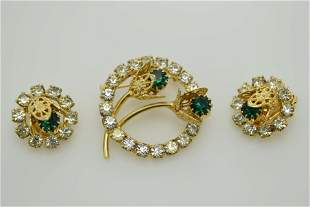A vintage pin and earring set.