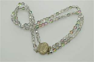 A two strand grey iridescent crystal bead necklace.