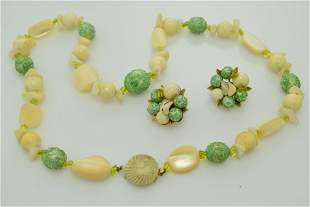 A vintage necklace and earring set marked Art.