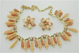 A vintage thermoset necklace and earring set with