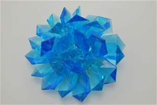 A vintage blue Lucite pin/brooch.