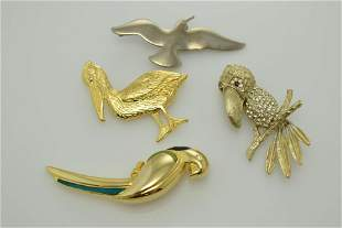 A lot of four vintage, bird shape pins/brooches. One is