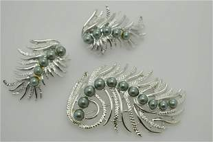 A vintage pin/brooch and earring set marked Sarah Cov.