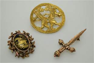 A lot of three gold tone pins/brooches.