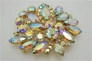 A vintage aurora borealis pin/brooch.