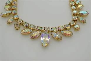 A vintage necklace with aurora borealis stones. Signed
