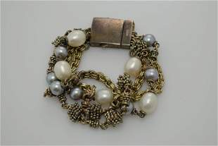 A new (pre owned) sterling silver and pearl bracelet